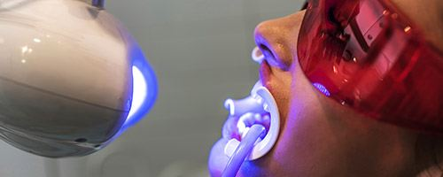 Patient receiving teeth whitening